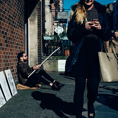 artist and the girl (gabor images) Tags: street city ireland people urban dublin man colour girl artist drawing candid streetphotography fujifilm streetsofdublin colourstreetphotography gaborimages fujixt1