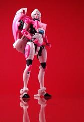 Arcee (thenatureboywoo) Tags: pink female mirror robot transformers g1 generations takara fembot hasbro redbackground generation1 arcee generationone femalerobot thrilling30