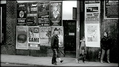Fact versus fiction (* RICHARD M (5 million views)) Tags: street matrix liverpool mono blackwhite candid families signsofourtimes posters innercity scousers familiy flyposting commercialism advertisments adverts merseyside familyouting popularculture signsofthetimes hoardings capitalofculture alltheworldsastage billposting thatslife europeancapitalofculture liverpudlians innercities innercityliverpool merseysiders factversusfiction unescocityofmusic liverpoolsdukestreet factvfiction