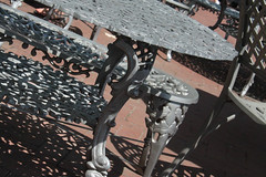 Dappled Shadows (lefeber) Tags: city nyc newyorkcity urban newyork leaves bench table chair shadows angles castiron dappled angled libertyisland