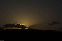 Sun behind clouds (Jan Zoric) Tags: sunset sky silhouette clouds cloudy horizon slovenia rays sunrays