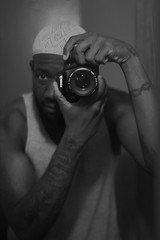 Tatted Muslim (Chrissy Tha Black) Tags: nyc blackandwhite bw monochrome tattoo canon lens 50mm mirror muslim islam selfie kufi melanin