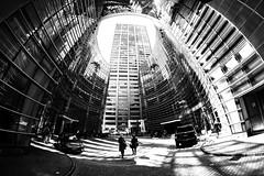 Birth canal (agruebl) Tags: nyc newyorkcity blackandwhite buildings lightandshadows noiretblanc manhattan schwarzweiss fisheyelens lichtundschatten birthcanal 8mmfisheye fujix fujixt1