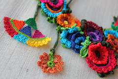 colorful floral statement necklace with red, pink, blue, purple, burgundy, orange and green crocheted flowers - Anemone Coronaria  by irregularexpressions (irregular expressions) Tags: red orange yellow purple turquoise burgundy limegreen crochet peach kawaii wearableart persimmon fiberart cobaltblue mahogany brightred textileart olivegreen crimsonred grassgreen royalblue indigoblue freeformcrochet flowernecklace artwear turquoiseblue crochetnecklace crochetedflowers crochetednecklace fuchsiapink colorfulnecklace crochetart cardinalred magentapink floralnecklace irregularexpressions bibnecklace chartreusegreen statementnecklace fibernecklace textilenecklace statementjewelry oversizednecklace wisteriapink