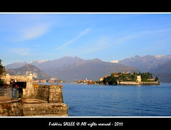Italy - Lovers on Lago Maggiore (Frdric Salle) Tags: world voyage camera morning italy mountain lake milan alps fall love montagne alpes automne canon lens landscape torino lago photography amazing italian kiss eau europe shoot shot lumire amor milano femme streetphotography award lac kisses lovers bleu explore amour feeling 1855mm 1855 paysage turin italie intimacy homme feelings lagomaggiore matin discover baiser amoureux voyages lombardy lombardie stresa piemont amoureuse italianlake lacmajeur italianlakes intimit embrasser baisers lesalpes pimont eos400d canoneos400d majorlake flickrtravelaward
