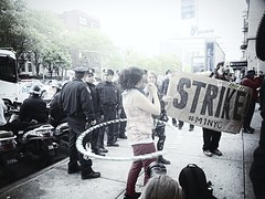 Strike n' Hoop (edit) (BW3200) Tags: protest streetphotography demonstration mayday 15mm olympusep1 garryvelletri