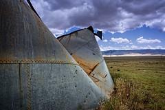 GONE SOUTH (akahawkeyefan) Tags: sky rust tank bulletholes crumpled carrizoplain davemeyer