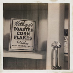HIP_Old Kellogg's Corn Flakes Box (banana razor) Tags: blackandwhite heritage handle box cereal burnaby cornflakes cupboard kelloggs burnabyvillagemuseum burnabyheritagevillage kelloggscornflakes hipstamatic