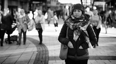 Hands in Pockets (Just Ard) Tags: street people blackandwhite bw woman white black blancoynegro girl monochrome face scarf person photography mono hands nikon dof noiretblanc zwartwit candid 85mm depthoffield d750 unposed  biancoenero pockets schwarzundweis