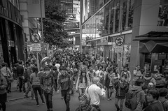 Bumping Along - Causeway Bay, Hong Kong (, ) (dlau Photography) Tags: life street city travel vacation people urban white black station weather subway bay outdoor muscle lifestyle style tourist hong kong busy  visitor soe causeway   bumping