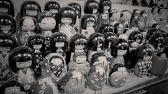 en masse (edwardpalmquist) Tags: california blackandwhite cute japan toys san francisco dolls japantown kokeshi