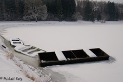 Three boats on the pond of Freux (Libramont) - Ardenne- Belgium / Trois barques sur l'étang principal de Freux (Libramont) - Ardenne- Belgique (Michaël Raty) Tags: schnee winter white snow cold ice nature landscape boats boat frozen pond frost belgium pentax snowy hiver nieve sneeuw neve neige paysage weiss blanc gel froid snowday glace givre étang ardenne libramont k10d freux
