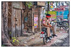 A cop on a Bullet (msankar4) Tags: india holy sikh gurdwara punjab amritsar trance goldentemple guru waheguru palki hymns holybook granth harmandirsahib sarover nihang tarntaran tarntaransahib sanctumsantorum granthsahib