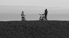 Smartphone Pictures From A Dike (Alfred Grupstra Photography) Tags: blackandwhite bw woman man nederland bikes smartphone nl dike noordholland wieringerwerf
