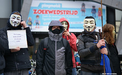Anonymous OpAwakening Gent (Red Cathedral is alive) Tags: march mask cosplay sony protest guyfawkes streetphotography vforvendetta alpha banners anonymous gent resistance resist larp manifestation redcathedral gunpowderplot occupy a850 eventcoverage sonyalpha aztektv millionmaskmarch leftwingdemonstration opawakening