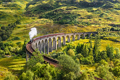 Glenfinnan Railway Viaduct (nicksimages.com) Tags: old uk greatbritain railroad travel bridge summer mountains tourism nature stone train vintage landscape scotland highlands construction scenery arch view unitedkingdom smoke famous scenic tracks engine harrypotter scottish railway landmark scene medieval historic retro steam glen viaduct journey valley rails historical locomotive express hogwarts glenfinnan attraction steamtrain wagons jacobite glenfinnanviaduct