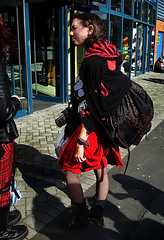Black and Red IV (Owen J Fitzpatrick) Tags: street camera city ireland red people dublin woman black anime net stockings girl beautiful beauty female lens photography j design stand costume nikon pretty comic pattern republic natural boots cosplay pavement candid character royal joe skirt eire jacket convention backpack use attractive only editorial hood owen brunette dslr unposed striking tamron society comicon con tartan chasing rds fitzpatrick mcm candidportrait candidphoto edgy candidphotography wristlets costumed ojf d3100 ojfitzpatrick
