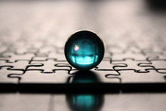 blue marble (overthemoon) Tags: blue home glass table interestingness puzzle explore marble 131 jigsawpuzzle notthegcc