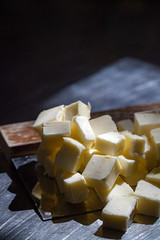 (080/366) Butter (CarusoPhoto) Tags: light macro window canon project john bench book cookbook is photo day natural cut mark cook butter ii 5d cubes 365 usm everyday caruso mundane banal scraper ordinary flavour 366 f28l ef100mm carusophoto ef100mmf28lmacroisusm