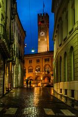 The two of us (elmarquex1) Tags: italy rain night umbrella europe piazza dei treviso signori