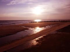 Bacton Beach Morning Walk (Alan FEO2) Tags: uk morning sea england sky sun reflection beach water clouds sunrise landscape sand waves shine outdoor norfolk panasonic promenade g1 82 dmc breakwater nurseryrhyme bacton asailorwenttosea 2oef 116picturesin2016 illustrateanurseryrhyme