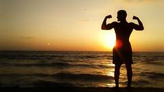 20160413_180544-01 (Dhammika Heenpella / Images of Sri Lanka) Tags: file:md5sum=e4d2be13ad53d4245008364ab3316773filesha1sig53a7fca8f1461e3bc20d441e4baa72846abc9843dhammikaheenpella imagesofsrilanka photos dhammikaheenpella lmagesofsrilanka srilanka photography mtlavinia beach heenpellas samsung silhouette power strength muscle