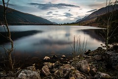 Distant Ship at Sunset (jasonmgabriel) Tags: sunset mountain reflection tree water rock clouds landscape scotland scenery long exposure hill loch lochy