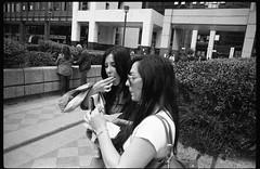 (Finger Food) (Robbie McIntosh) Tags: leica girls blackandwhite bw film monochrome analog 35mm women candid 28mm strangers streetphotography rangefinder bn negative mp analogue streetfood ilford fp4 biancoenero argentique fingerfood cdn dyi selfdeveloped ilfordfp4 centrodirezionale pellicola elmarit analogico leicamp leicam filmisnotdead autaut leicaelmarit28mmf28iii elmarit28mmf28iii arsimagofd arsimagofddeveloper streetfoodinternationalfestival arsimagofd139