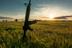 A soldier's sunset (jlstein339) Tags: sunset sky work landscape army outdoors apache raw aviation sony wideangle cybershot helicopter weapon blackhawk m4 carbine jrtc rx100iv