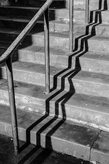 20/01/2016 - Follow the lines (jokerdog1) Tags: street light shadow blackandwhite bw sunlight monochrome up lines stone stairs bars shadows steps down line step rails descend bent sunlit twisted zigzag ascend