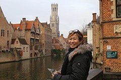 Kanitha at the picturesque Dijver in Brugge (Bn) Tags: world city venice winter portrait panorama holiday tower heritage beer caf beauty fog architecture fairytale night walking town topf50 belgium postcard centre gothic sightseeing brugge belgi visit tourist medieval canals unesco bruges middle picturesque flemish ages painters gem belfort chocalate bycicle photogenic dijver guildhouse vlaanderen rozenhoedkaai 50faves wateren