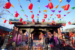 Fire God temple Beijing - incense, lanterns and flags (Bruce in Beijing) Tags: history temple religion beijing culture traditions flags daoist taoist incenseburner springfestival shichahai redlanterns qianhai xicheng templearchitecture jaderiver firegodtemple huodezhenjuntemple