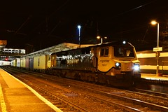 Loco 70017 sits at Ipswich with the Ditton - Felixstowe North Freightliner service, waiting to go into Ipswich Yard, whilst behind it, 2 x Class 170s are departing ECS to Norwich.  05 02 2016 (pnb511) Tags: railway trains container freight ipswich intermodal geml class70 greateasternmainline