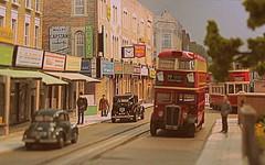 Along the High Street (kingsway john) Tags: london austin taxi transport models tram morris minor stl e1 kingsway fx3