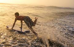 surfs up (Sjafiroeddin, C) Tags: ocean california boy sunset sun playing beach water kids fun warm waves play spray splash saltwater boogieboard