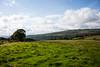 Green land of Wales (Melvinia_) Tags: uk blue panorama green nature southwales wales clouds landscape unitedkingdom cymru vert bleu ciel fields nuage paysage danyrogof coelbren canoneos450d digitalrebelxsi