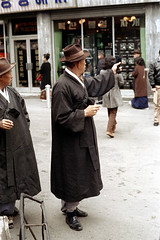 31-241 (ndpa / s. lundeen, archivist) Tags: street city winter people man color men fall film hat 35mm store women candid coat nick citylife hats streetphotography streetlife korea korean seoul storefront pedestrians 1970s coats southkorea 1972 31 dewolf overcoat onfoot nickdewolf photographbynickdewolf reel31
