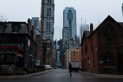 Lone Walker, Rainy Foggy Day (-dmlb) Tags: city toronto building tower rain fog dark walking person alone gloomy foggy sombre walker rainy lone roadway sidestreet entertainmentdistrict