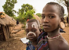 Mursi Girls, Ethiopia (Rod Waddington) Tags: africa girls two portrait people face female village outdoor african painted culture valley afrika omovalley ethiopia ethnic mago cultural ethnicity afrique earplug ethiopian omo etiopia ethiopie etiopian