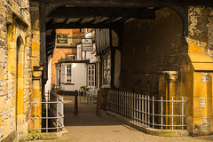 The Gateway (Explored) (williamrandle) Tags: road uk england stone architecture spring cafe alley nikon arch outdoor alleyway markettown thegateway 2016 evesham d7100 tamron2470f28vc