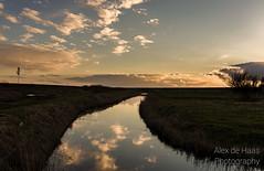 DSC_6624_Lr-edit (Alex-de-Haas) Tags: light sunset reflection water netherlands clouds landscape fire licht zonsondergang nederland thenetherlands wolken dyke dijk dike landschap noordholland vuur reflectie petten coastalarea spreeuwendijk kunstgebied