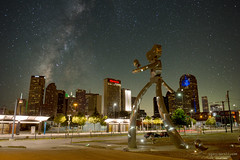 Walking Tall (Sergio Garcia Rill) Tags: city sculpture usa building art statue metal composite night photoshop buildings stars us dallas downtown texas nightscape unitedstates places fantasy nightsky deepellum milkyway 2014 walkingtall travelingman bradoldham