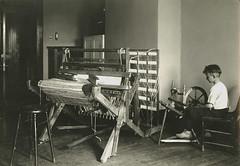 Siting at a spinning wheel. (NDSU University Archives) Tags: textile ndsu spinningwheel homeeconomics looms ndac northdakotastateuniversity northdakotaagriculturalcollege