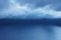 Blue Light (FiddleHiker) Tags: longexposure blue lake mountains water clouds landscape volcano topf50 ambientlight bluesky crater volcanic craterlakenationalpark bluemonday