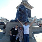 Students pose for a photo in front of a lion sculpture