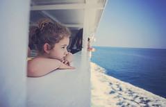 Sailing away (Wojtek Piatek) Tags: ireland sea summer portrait italy holiday girl zeiss 50mm boat sailing sad sony sonya99