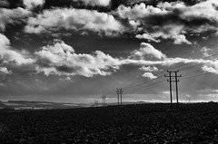 Cold Grey Morning (amber654) Tags: england sky blackandwhite bw music cloud monochrome field landscape mono wire nikon song derbyshire cable pole 18105 lyric chrisrea duckmanton iwillgoon d5100 nikond5100