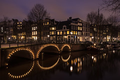 This is Amsterdam (McQuaide Photography) Tags: old city longexposure bridge winter light urban house holland reflection water netherlands dutch amsterdam architecture zeiss outside licht boat canal twilight lowlight europe waterfront outdoor dusk sony traditional tripod capital nederland atmosphere wideangle brug fullframe alpha huis residential atmospheric waterside stad authentic manfrotto noordholland gracht brouwersgracht huizen wideanglelens capitalcity 1635mm northholland a7ii groothoek phaseone variotessar captureone mirrorless sonyzeiss mcquaidephotography ilce7m2 captureonepro9