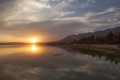 Sunset over the Malecon (Eunice Gibb) Tags: sunset lake mexico sundown jalisco sierra malecon boardwalk ajijic axixic sunsetonthemalecon lakechapala mexicansunset sunsetoverwater mexicanlake lakeinmexico ajijicsunset lakechapalasunset sunsetonajijicmalecon sierradesanjuancosala