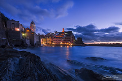 Vernazza Blue Hour (Claudio Russa Photography) Tags: park travel blue winter sea sky italy seascape beach water clouds landscape lights coast seaside amazing dock sand nikon bravo rocks long exposure italia waves cloudy five liguria tags national hour cinqueterre lands popular vernazza d700
